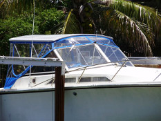Hard To Top hardtop attached on Bayliner flybridge including additional side curtains